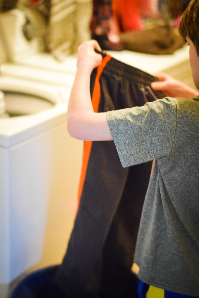 As part of our family's laundry routine, our older kids do their own laundry.