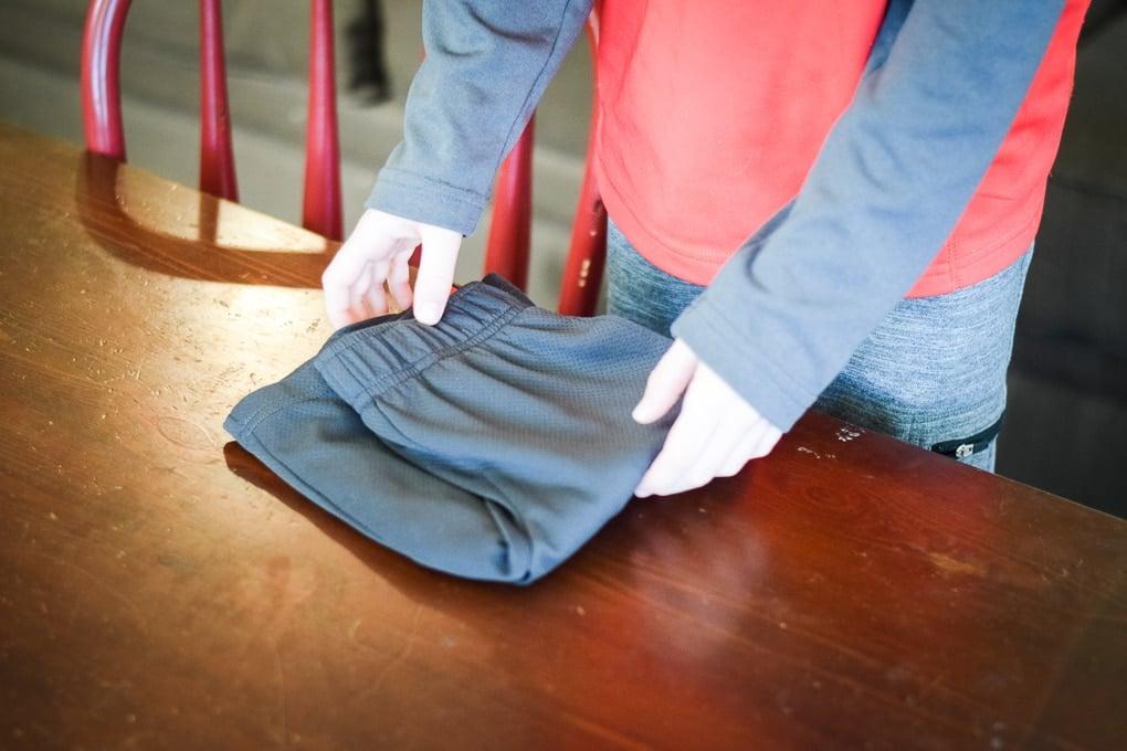 The Official Hot Dog and Hamburger Method of Folding Laundry.